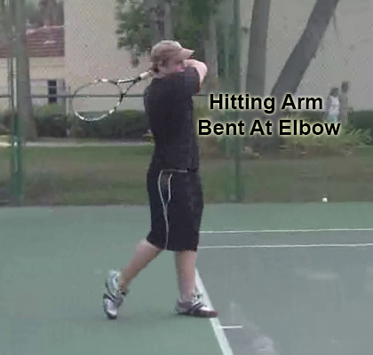 forehand_follow_through_recovery_arm_bent_elbow