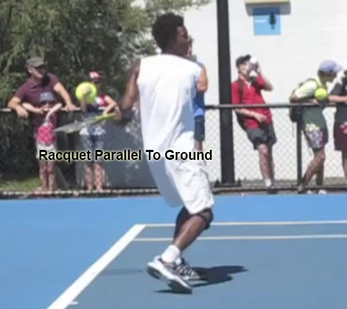 forehand_follow_through_recovery_racquet_parallel_ground