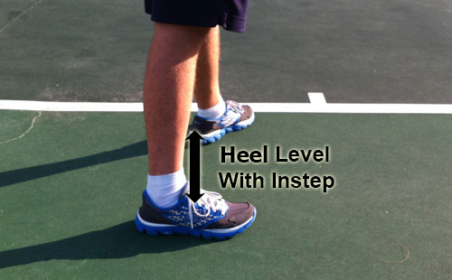 serve_starting_position_feet_instep_heal