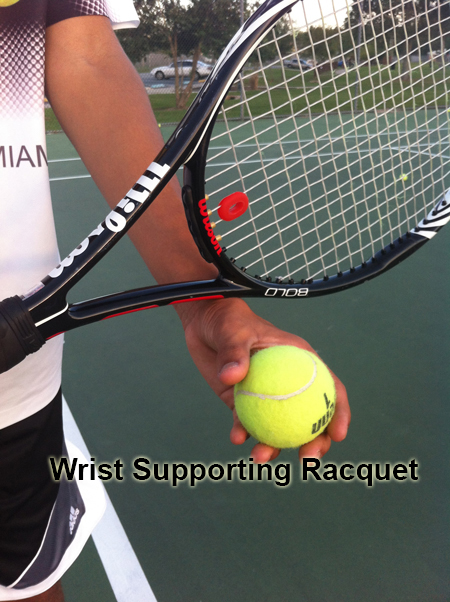 serve_starting_position_wrist_supporting_racquet